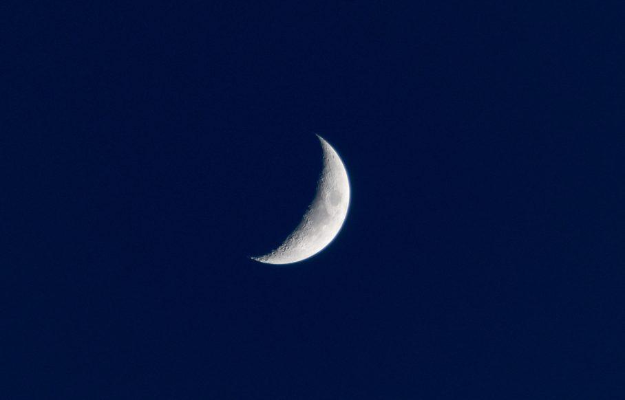 half moon on dark blue night sky